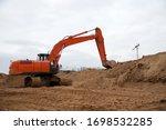 Large Excavator Working At...