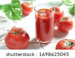 Tomato Juice With Tomatoes On...