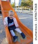 Cheerful Little Girl Is Happy...