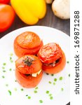 three stuffed tomatoes on a... | Shutterstock . vector #169871288