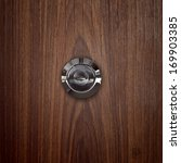 door lens peephole on lwooden.  | Shutterstock . vector #169903385