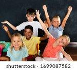 smiling little beautiful girls... | Shutterstock . vector #1699087582
