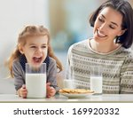 Girl Drinking Milk At The...