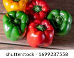Colorful Bell Pepper On A Wood...
