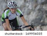 woman on road cycle scrape the... | Shutterstock . vector #169956035