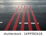 Red Rumble Strips On The Road....