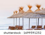 Beach Thatched Umbrellas On The ...