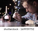 drunk man drinking vodka at the ... | Shutterstock . vector #169959752