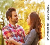 young couple in love outdoor | Shutterstock . vector #169960382