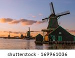 Stock photo traditional dutch windmills with canal in zaanse schans near the amsterdam holland 169961036