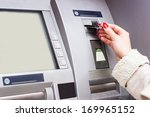 Woman Using Credit Card To...