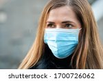 Young woman wearing disposable...