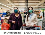 Shoppers With Masks Buying For...