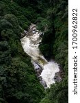a beautiful waterfall in the lap of mountain - stock photo