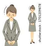 the female of the suited figure ... | Shutterstock .eps vector #1701209878