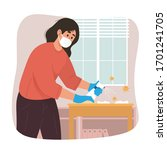 young woman cleaning table with ... | Shutterstock .eps vector #1701241705