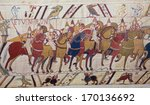 BAYEUX, FRANCE - FEB 12: Detail of the famous Bayeux Tapestry depicting the Norman invasion of England in the 11th Century on February 12, 2013. - stock photo