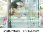 Woman With The Surgical Mask...
