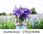 A Hippy Girl Holding Bouquet Of ...