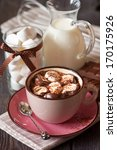 Cup of sweet hot chocolate with marshmallow. - stock photo