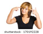 Small photo of Closeup portrait of an angry pretty young woman gesturing with her fingers against temple asking are you crazy? Isolated on white background. Negative human emotions facial expression feelings