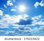 sun in a blue cloudy sky | Shutterstock . vector #170215622