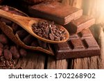 Cocoa Beans And Cocoa Pod On A...