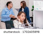 Small photo of Asian Business woman be curious and listening the couple talking about lovers problem while working hour at modern office, gossip and secret, eavesdrop and whisper, relationship in office concept