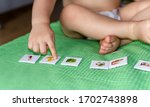 child lining up toys on the... | Shutterstock . vector #1702743898
