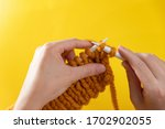 women's hands knit from yellow... | Shutterstock . vector #1702902055