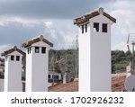 White Painted Village Chimneys...