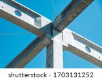 Industrial construction on site of new warehouse factory buildings. Concrete beams, girders - stock photo