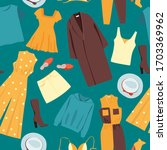 different clothes on a green... | Shutterstock .eps vector #1703369962