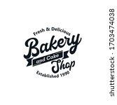 bakery and cake vintage logo... | Shutterstock .eps vector #1703474038