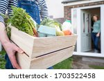 Home Delivery Of Fresh Produce Outside House Observing Safe Social Distancing During Coronavirus Covid-19 Pandemic