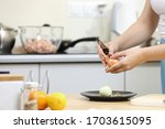 young woman cooking in kitchen. ...