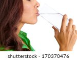 profile of pretty girl drinking ... | Shutterstock . vector #170370476