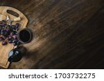On A Wooden Table  A Bottle Of...