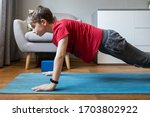 Small Boy On Yoga Mat At Home...