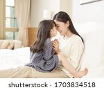 loving asian mother and cute... | Shutterstock . vector #1703834518