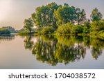 river  trees. pripyat river in...   Shutterstock . vector #1704038572