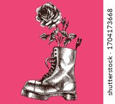 modern brutal boot with rose.... | Shutterstock .eps vector #1704173668