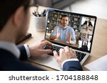 Small photo of Businessman boss leader leads distant communication diverse businesspeople involved in group videocall conversation discuss common project, partners negotiating. Modern technology and business concept