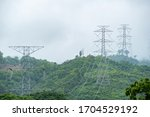 high voltage pole and line cable electrical transmission energy supply to industry in Mountain forest. concept  save energy - stock photo