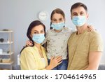 Family in medical masks on the...