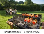 shashlick laying on the grill... | Shutterstock . vector #170464922