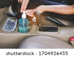 Small photo of Use Sanitizer hand gel to wash hands every time when getting in a car. In order to kill germs or the corona virus