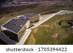 Small photo of Helmstedt, Germany, March 21., 2020: Aerial view of a modern building with strict geometry and a splayed facade with a flat roof, from the side