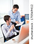 two colleagues discussing... | Shutterstock . vector #170569412