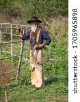 Small photo of Ranch owner. Lasso tool. oldman long white beard whiskers western cowboy. Lasso tied wrapped. Western life. attle breeding concept. Cowboy at countryside. Ranch occupations. Man cowboy nature.